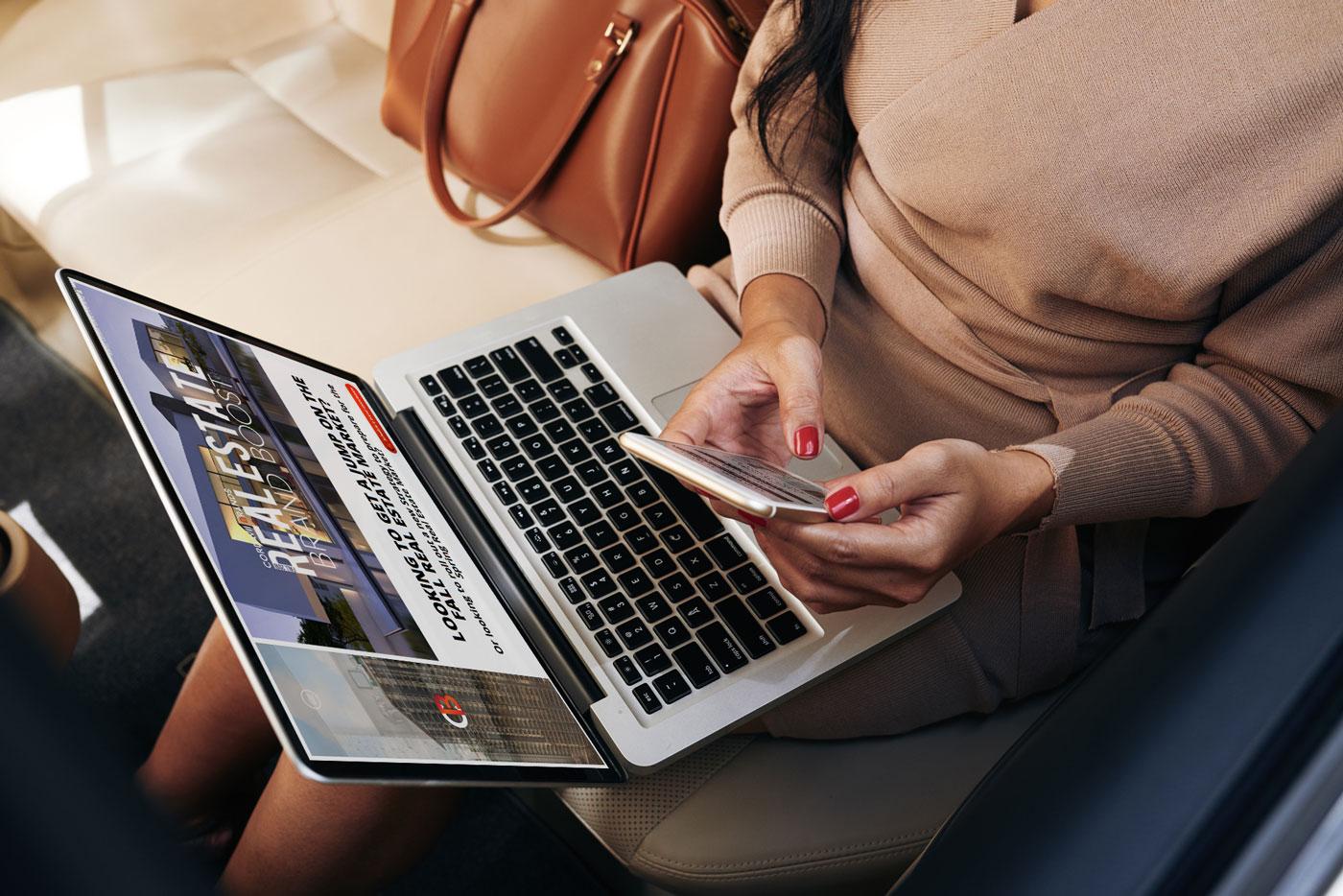 Realtor on Laptop Scheduling Cordavii Brands Brand Boost