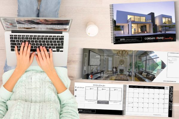 Lady on Computer next to the Cordavii 2019 Real Estate Marketing Calendar Back Cover